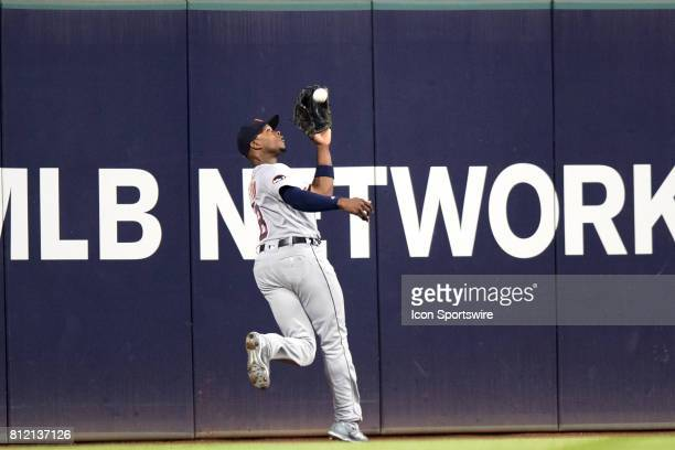 Detroit Tigers left fielder Justin Upton makes a catch on the warning track during the eighth inning of the the Major League Baseball game between...