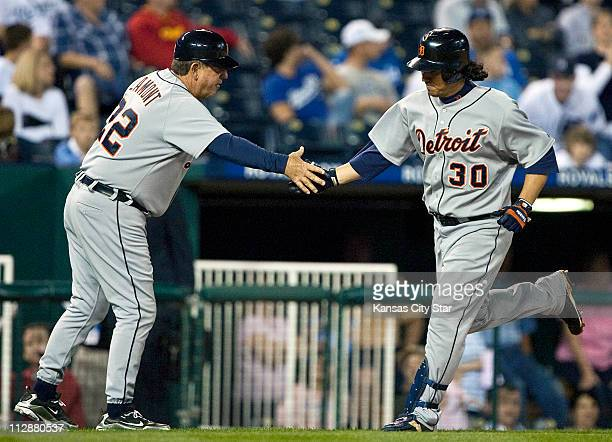 Detroit Tigers' Magglio Ordonez is congratulated by third base coach Gene Lamont after hitting a ninth inning solo home run against the Kansas City...