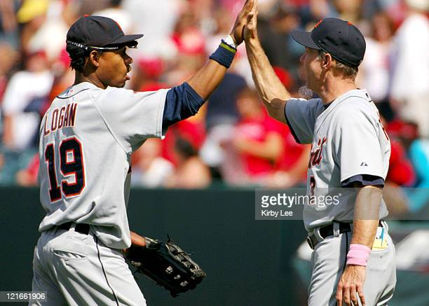 Detroit Tigers manager Alan Trammell exchanges high five with Craig Monroe after 101 victory over the Los Angeles Angels of Anaheim at Angel Stadium...