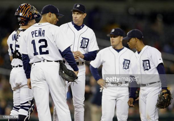 Detroit Tigers' manager Allen Trammell waits for a new pitcher with his infield during eighth inning action against the Minnesota Twins in at...