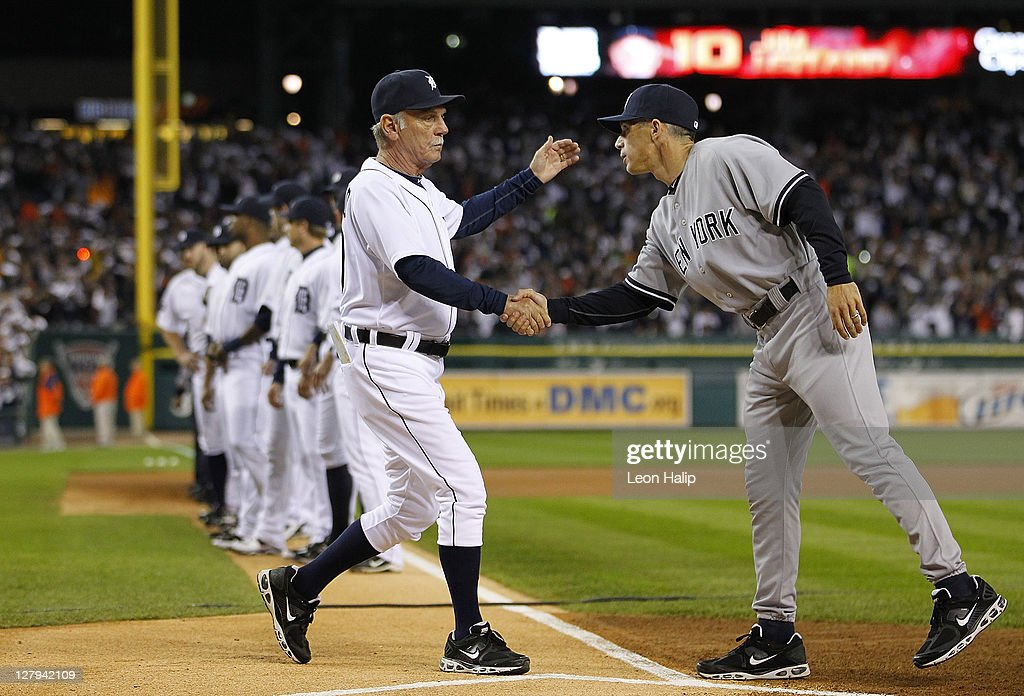 Detroit Tigers manager Jim Leyland #10 and New York Yankees manager Joe Girardi #28 shake hands prior to the start of the game at Comerica Park on October 3, 2011 in Detroit, Michigan.