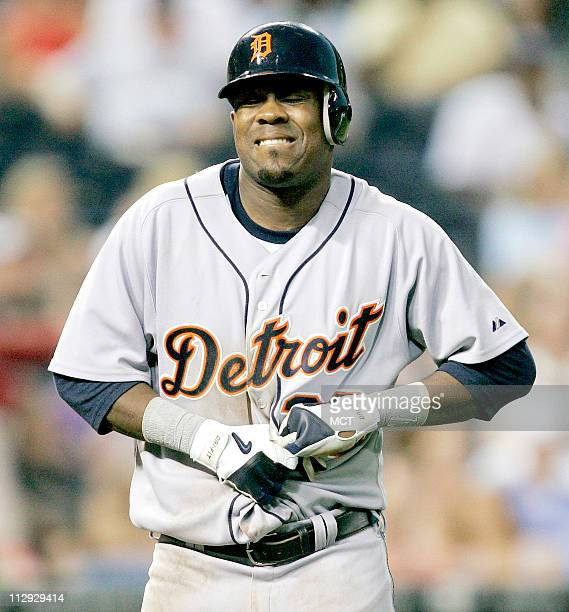Detroit Tigers' Marcus Thames reacts in pain to being hit in the hand by a pitch from Kansas City Royals' Mike Woods in the sixth inning The Tigers...
