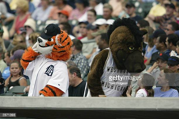 Detroit Tigers mascot, Paws, and the Western Michigan University mascot, Buster Bronco, attend the MLB game between the Tigers and the Kansas City...