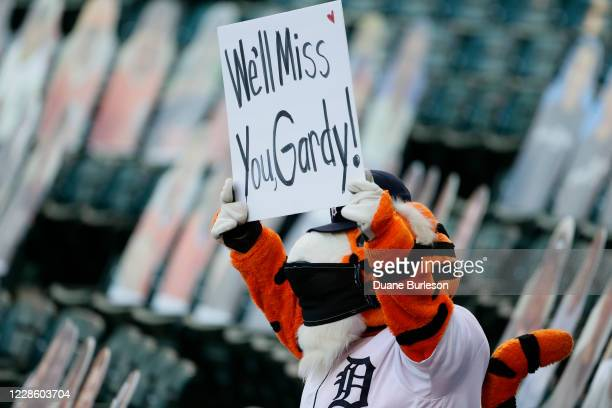 Detroit Tigers mascot Paws holds up a sign for former Tigers manager Ron Gardenhire who announced his immediate retirement from managing in a meeting...