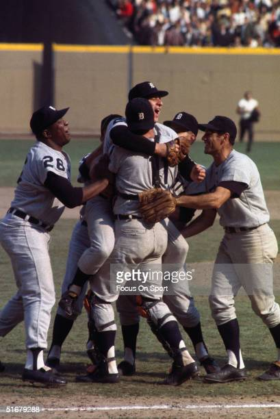 Detroit Tigers mob the pitcher Mickey Lolich Gates Brown on the left and Dick McAuliffe on the right celebrating after winning Game Seven of the...