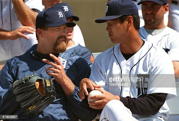 Detroit Tigers pitcher Doug Brocail and newly acquired pitcher Masao Kida of Japan talk in the bullpen during the spring training game with the...