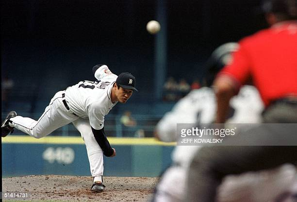 Detroit Tigers' pitcher Masao Kida delivers a pitch in the seventh inning to a Minnesota Twins batter 27 June 1999 in Detroit Kida pitched two...