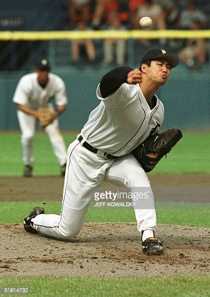 Detroit Tigers pitcher Masao Kida delivers a pitch in the seventh inning to a Minnesota Twins batter 27 June 1999 Kida pitched two innings giving up...