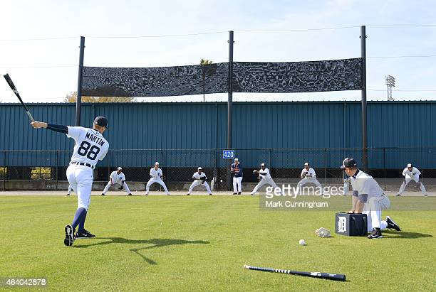 Detroit Tigers pitchers and coaches participate in a rag ball fielding drill during Spring Training workouts at the TigerTown Facility on February 21...