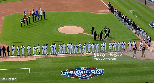 Detroit Tigers players and coaches line up on the field during player introductions prior to the Opening Day game against the New York Yankees at...