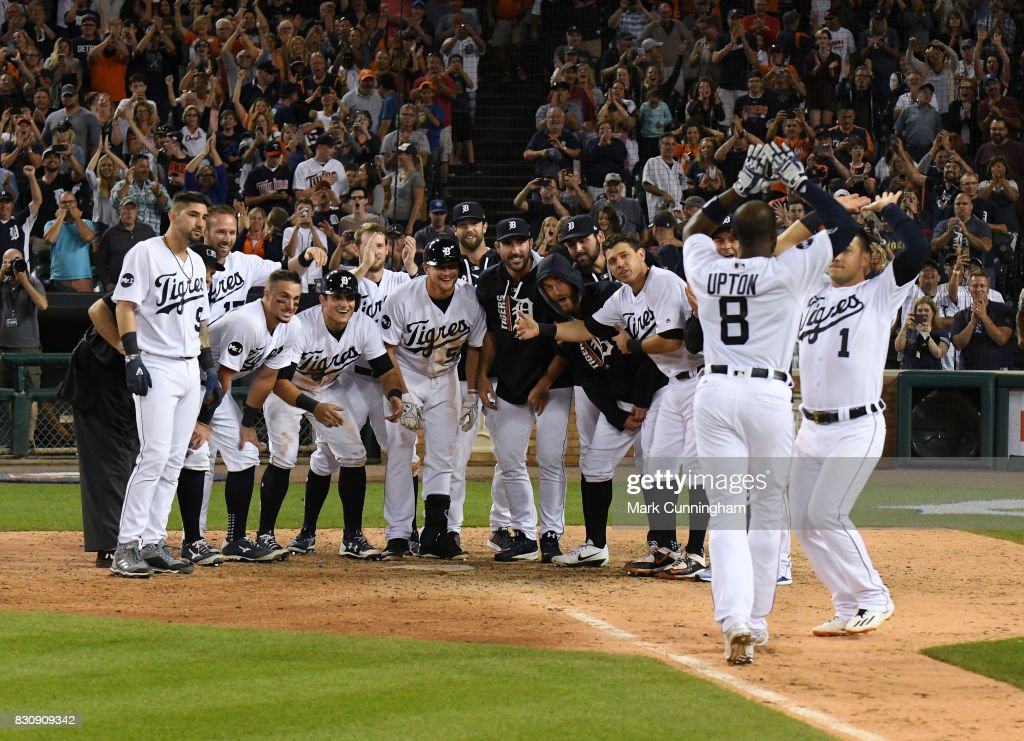 Detroit Tigers players wait at home plate to greet Justin Upton #8 after he hit a walk-off two-run home run in the bottom of the ninth inning of the game against the Minnesota Twins at Comerica Park on August 12, 2017 in Detroit, Michigan. The Tigers defeated the Twins 12-11.