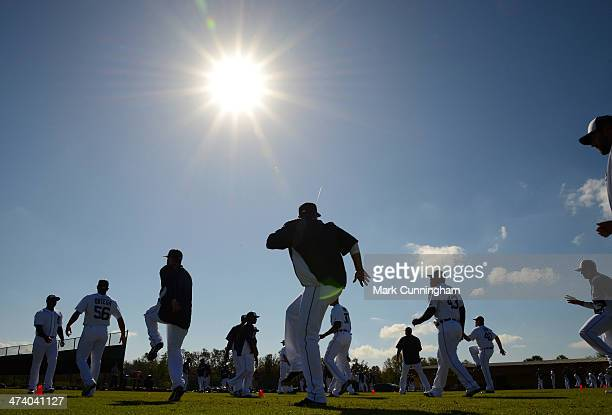 Detroit Tigers players warm up under the Florida sun during the spring training workout day at the TigerTown complex on February 20 2014 in Lakeland...