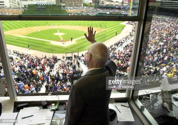 Detroit Tigers radio broadcaster Ernie Harwell waves to the crowd during the seventh inning stretch in the game with the New York Yankees in Detroit...