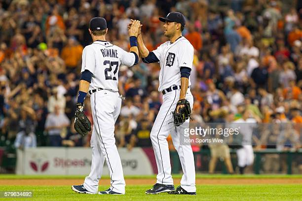 Detroit Tigers relief pitcher Joakim Soria celebrates with Detroit Tigers shortstop Andrew Romine at the conclusion of a regular season game between...