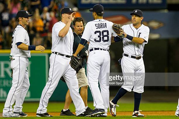 Detroit Tigers relief pitcher Joakim Soria receives congratulations from teammates Ian Kinsler Marc Krauss and Andrew Romine at the conclusion of a...