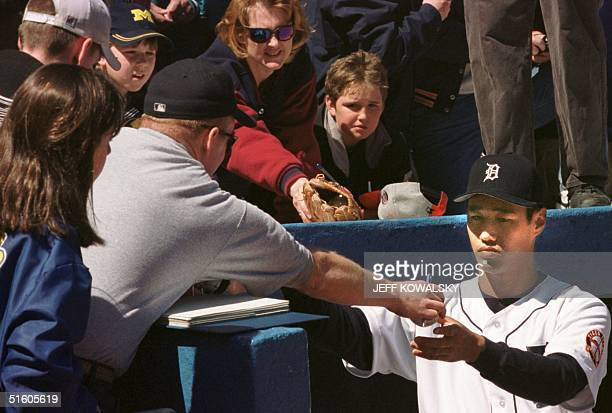 Detroit Tigers relief pitcher Masao Kida from Japan signs autographs for fans before the start of their game against the Minnesota Twins on 12 April...