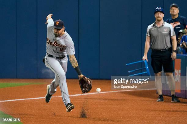 Detroit Tigers Right field Nicholas Castellanos toys to catch a foul ball that bounced into the stands from the track during the MLB game between the...