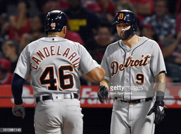 Detroit Tigers right fielder Nicholas Castellanos greets third baseman Jeimer Candelario at the plate after Candelario hit a two run home run in the...