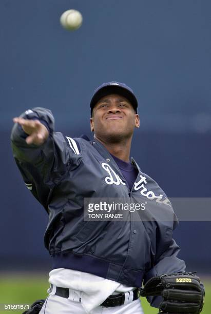 Detroit Tigers right fielder Roger Cedeno warms up before the start of the spring training game with the Cleveland Indians at Marchant Stadium in...