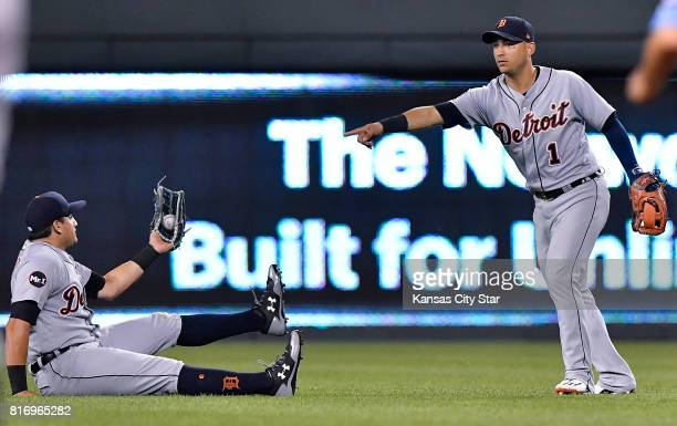 Detroit Tigers shortstop Jose Iglesias points to center fielder Mikie Mahtook after catching a bloop out by Kansas City Royals' Billy Burns for an...