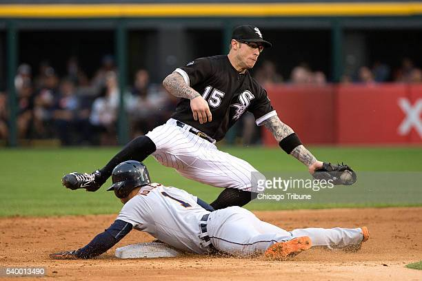 Detroit Tigers shortstop Jose Iglesias slides past Chicago White Sox second baseman Brett Lawrie to steal second base during the second inning on...