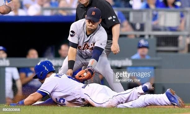 Detroit Tigers shortstop Jose Iglesias tags out the Kansas City Royals' Whit Merrifield to end the fifth inning in a rundown on a grounder by Alex...