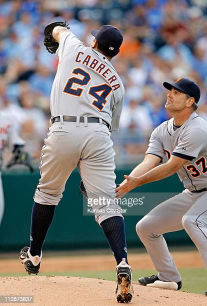 Detroit Tigers starting pitcher Kenny Rogers backs up Tigers first baseman Miguel Cabrera as he fields a pop fly on the mound hit by Kansas City...