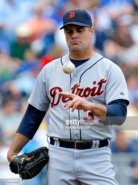 Detroit Tigers starting pitcher Kenny Rogers plays with the ball in the second inning after giving up a run to the Kansas City Royals. The Royals...