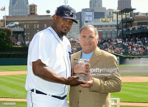 Detroit Tigers Vice President and Assistant General Manager Al Avila poses for a photo with Jose Valverde after presenting him with his 2011 GIBBY...