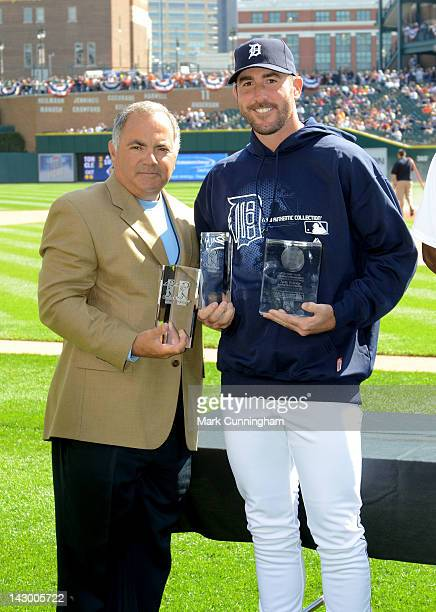 Detroit Tigers Vice President and Assistant General Manager Al Avila poses for a photo with Justin Verlander after presenting him with his 2011...