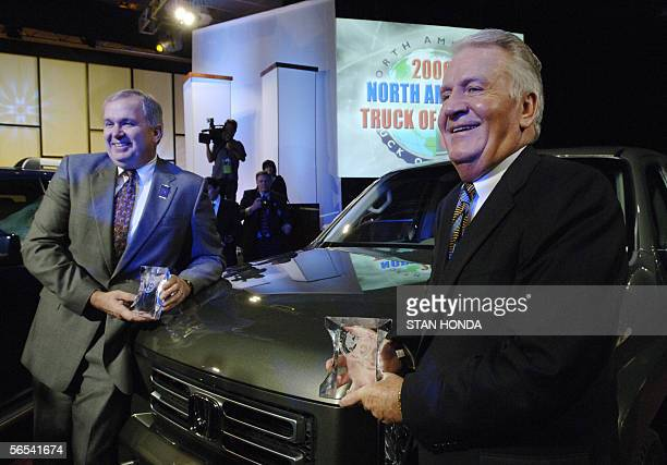 Dick Colliver executive vicepresident of Honda and John Mendel senior vicepresident of Honda stand next to the Honda Ridgeline the 2006 North...