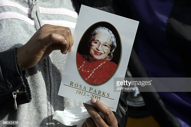 Mary Marow of Detroit MI holds a photo of civil rights activist Rosa Parks outside the Charles H Wright Museum of African American History in Detroit...