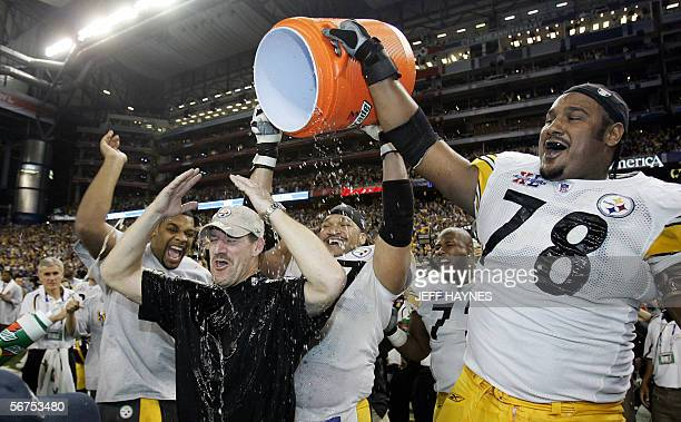 Pittsburgh Steelers head coach Bill Cowher gets doused with water by his player Max Starks after his team won the Super Bowl 2110 against the Seattle...