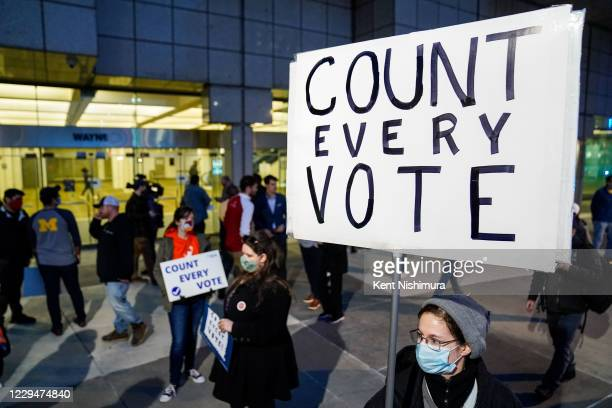 Detroit Will Breathe supporter Betsy Camaredo of Hazel Park holds a sign that says Count Every Vote outside of the Detroit Department of Elections...
