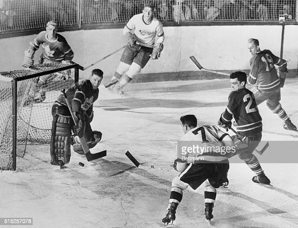 Winging It In Ted Lindsay captain of the Detroit Red Wings drives the puck past Harry Lumley Toronto Maple Leafs goalie to score in the third period...