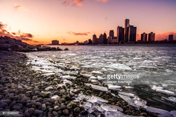 detroit - winter sunset - detroit river stock pictures, royalty-free photos & images