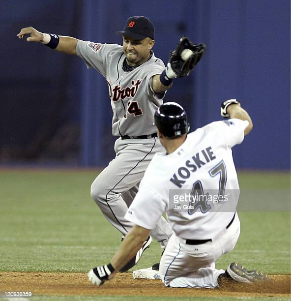 Detroit's Placido Polanco takes the throw at 2nd just ahead of a sliding Corey Koskie in the Detroit Tigers vs Toronto Blue Jays at the Rogers Centre...