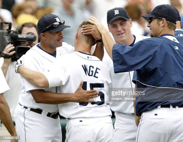Detrot Tiger catcher Brandon Inge is congradulated by players and coaches after hitting a two run home run in the bottom of the ninth inning to beat...