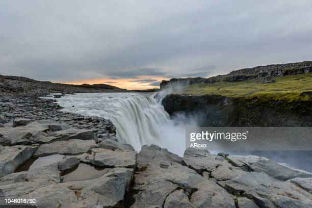 dettifoss is a waterfall in vatnajokull national park in iceland, and is the most powerful waterfall in europe - national park stock pictures, royalty-free photos & images
