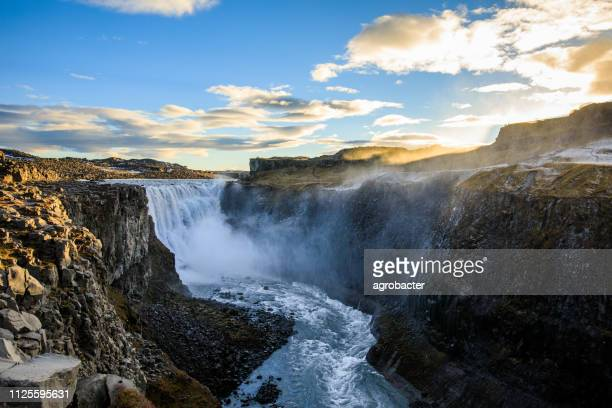 dettifoss is a waterfall in vatnajokull national park in iceland - dettifoss waterfall stock photos and pictures