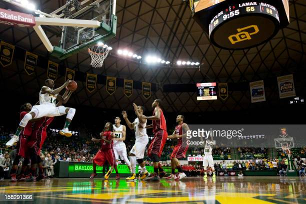 Deuce Bello of the Baylor University Bears drives to the basket against the Lamar Cardinals on December 12 2012 at the Ferrell Center in Waco Texas