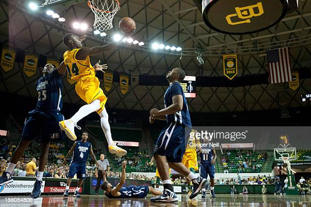 Deuce Bello of the Baylor University Bears makes a layup against the Jackson State University Tigers on November 11 2012 at the Ferrell Center in...