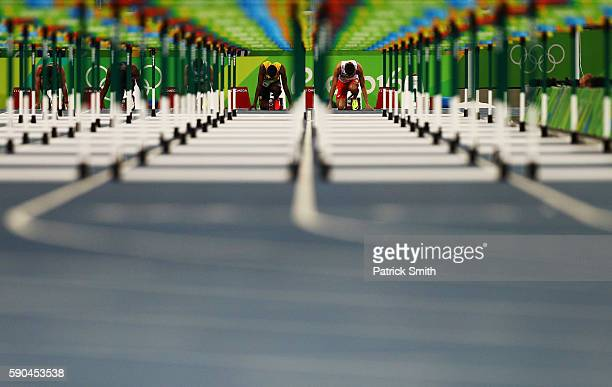 Deuce Carter of Jamaica and Damian Czykier of Poland wait for the start of the Men's 110m Hurdles Semifinals on Day 11 of the Rio 2016 Olympic Games...