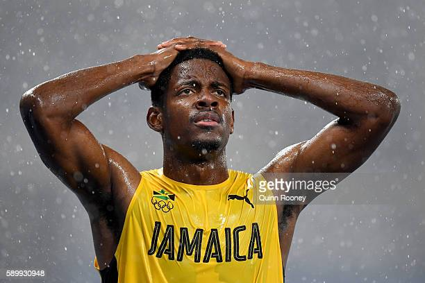 Deuce Carter of Jamaica reacts as it rains during the Men's 110m Hurdles Round 1 Heat 2 on Day 10 of the Rio 2016 Olympic Games at the Olympic...