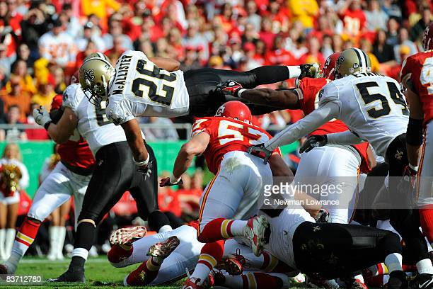 Deuce McAlister of the New Orleans Saints dives over for a touchdown against the Kansas City Chiefs on November 16, 2008 at Arrowhead Stadium in...