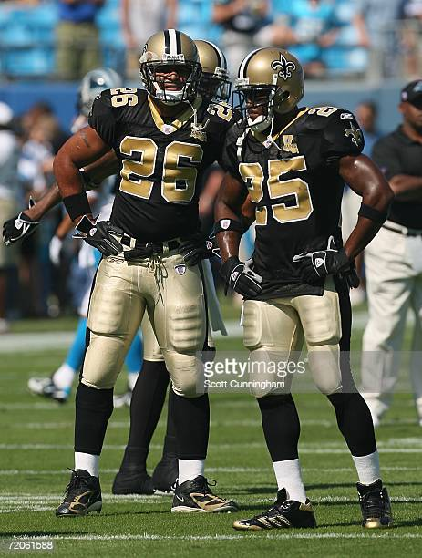 Deuce McAllister and Reggie Bush of the New Orleans Saints stand together before their game against the Carolina Panthers at Bank Of America Stadium...