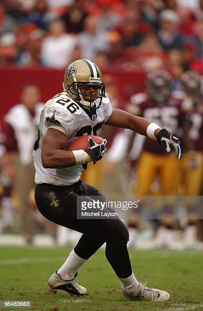 Deuce McAllister of the New Orleans runs withe ball a during a NFL football game against the Washington Redskins on October 13 2002 at FedEx Field in...