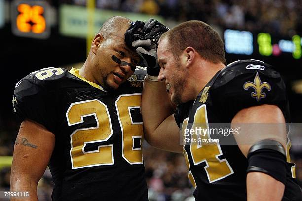 Deuce McAllister of the New Orleans Saints celebrates his touchdown run with Mike Karney in the third quarter against the Philadelphia Eagles during...