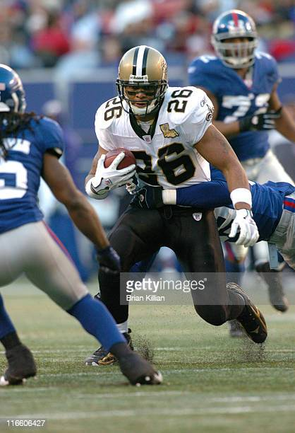 Deuce McAllister of the New Orleans Saints during a game between the New Orleans Saints and New York Giants at Giants Stadium in East Rutherford New...