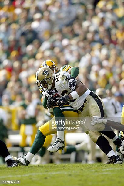 Deuce McAllister of the New Orleans Saints gets tackled by Nick Barnett of the Green Bay Packers during a game on October 9 2005 at Lambeau Field...
